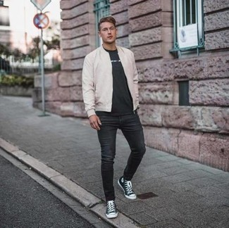 Black Skinny Jeans Outfits For Men: Consider wearing a beige bomber jacket and black skinny jeans for relaxed dressing with a modern twist. Hesitant about how to finish off? Complete this look with black and white canvas high top sneakers to mix things up.