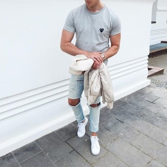 How to Wear White Plimsolls For Men: This bold casual combination of a beige bomber jacket and light blue ripped skinny jeans can only be described as seriously stylish. Take a sleeker approach with footwear and introduce white plimsolls to the equation.