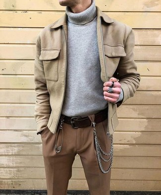 A beige suede bomber jacket and a Saks Fifth Avenue men's Collection Full Grained Leather Belt are absolute essentials if you're picking out an off-duty wardrobe that holds to the highest style standards. When you're having one of those bleak autumn days, sometimes only a cool getup like this one can get you to face the outside world.
