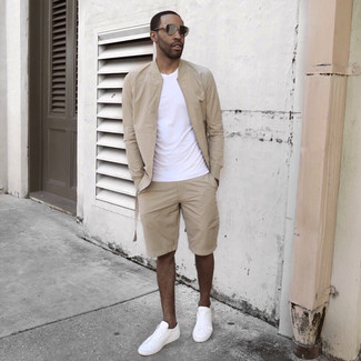 How to wear: beige bomber jacket, white crew-neck t-shirt, beige shorts, white low top sneakers