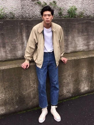 How to Wear a Bomber Jacket For Men: You'll be surprised at how easy it is for any gentleman to get dressed this way. Just a bomber jacket and blue jeans. If you want to break out of the mold a little, introduce white canvas high top sneakers to this look.