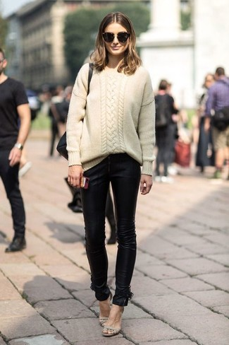 How to wear: beige cable sweater, black leather skinny jeans, beige leather heeled sandals, black sunglasses