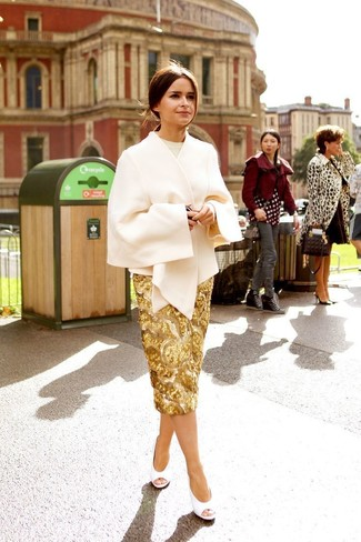 How to wear: beige cape coat, beige crew-neck sweater, gold sequin pencil skirt, white cutout leather pumps