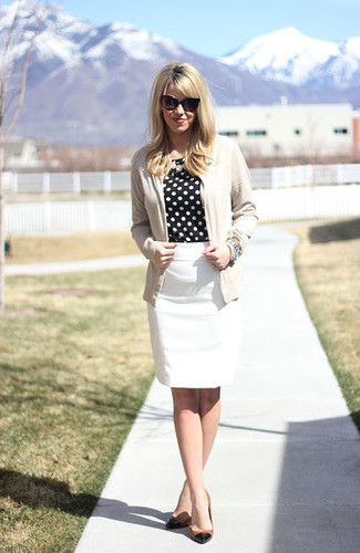How to wear: beige cardigan, black and white polka dot long sleeve blouse, white pencil skirt, black and tan leather pumps