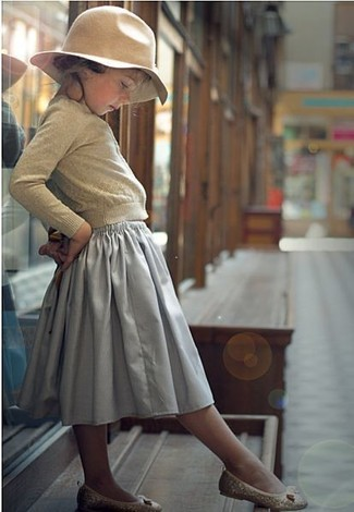 How to Wear a Grey Skirt For Girls: Consider dressing your child in a beige cardigan with a grey skirt to create a smart casual look. Round off this style with beige ballet flats.
