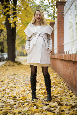 How to wear: beige coat, beige sweater dress, black leather over the knee boots, black print tights