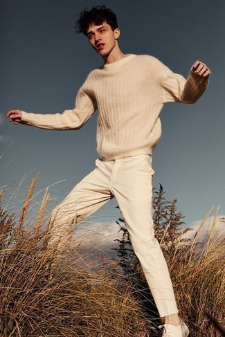 Beige Crew-neck Sweater Spring Outfits For Men: A beige crew-neck sweater and beige chinos will convey this relaxed and dapper vibe. A pair of white leather low top sneakers will give a playful feel to this ensemble. So as you can see, it's a killer, not to mention spring-appropriate, outfit to keep in your seasonal collection.