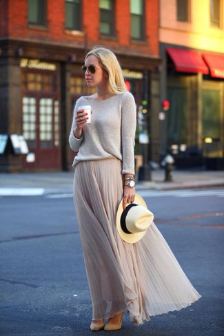 Consider wearing a beige crew-neck pullover and a nude pleated chiffon maxi skirt for a glam and trendy getup. Khaki suede pumps will instantly smarten up even the laziest of looks.
