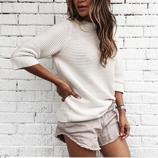 For an outfit that provides comfort and fashion, consider teaming a beige crew-neck sweater with beige shorts. Super cool and entirely summer-appropriate, you can wear a variation of this getup all summer long.