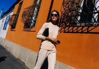 How to wear: beige crew-neck sweater, beige tapered pants, black leather clutch