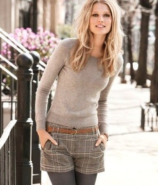 Pair a nude crew-neck jumper with brown check wool shorts to create a chic, glamorous look.