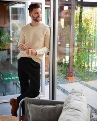Beige Crew-neck Sweater Fall Outfits For Men: Try teaming a beige crew-neck sweater with dark green corduroy chinos for both on-trend and easy-to-style ensemble. A good pair of brown suede casual boots is an easy way to give a touch of refinement to this outfit. As you can see here, it's very easy to look amazing and stay comfortable come chillier weather, thanks to this getup.