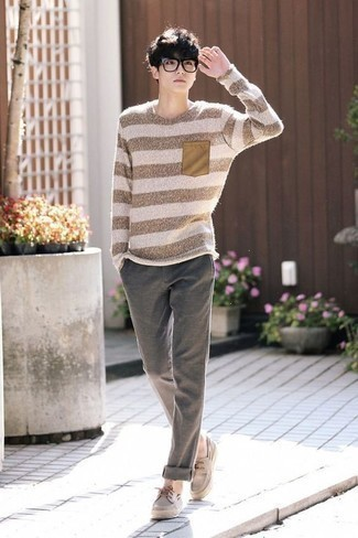 How to Wear Grey Chinos: This off-duty combination of a beige horizontal striped crew-neck sweater and grey chinos is a tested option when you need to look neat and relaxed but have no time. A pair of beige suede boat shoes serves as the glue that will bring this look together.