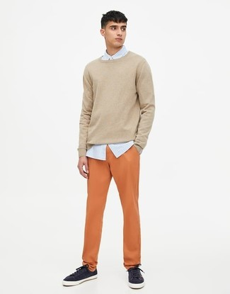 How to wear: beige crew-neck sweater, light blue vertical striped dress shirt, orange chinos, navy low top sneakers