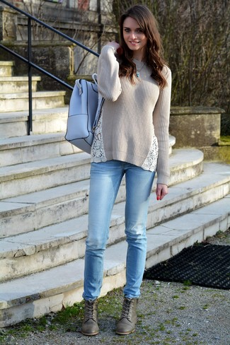 Effortlessly blurring the line between chic and casual, this combination of a nude crew-neck pullover and light blue jeans is likely to become one of your favorites. A pair of army green leather lace-up boots brings the dressed-down touch to the ensemble.
