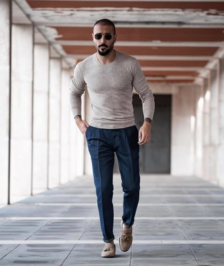 How to wear: beige crew-neck sweater, navy chinos, beige suede tassel loafers, black and gold sunglasses
