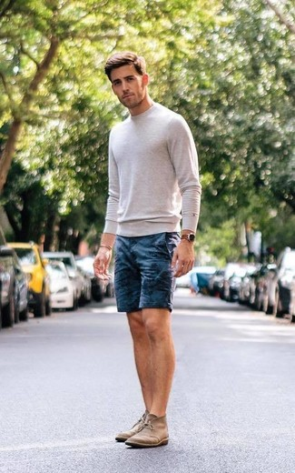 How to wear: beige crew-neck sweater, navy print shorts, brown suede desert boots, brown leather watch