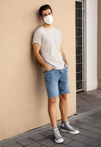 Blue Denim Shorts Outfits For Men: Rock a beige crew-neck t-shirt with blue denim shorts to pull together a casually cool ensemble. Finishing with a pair of grey canvas high top sneakers is an effortless way to introduce a more casual spin to this outfit.