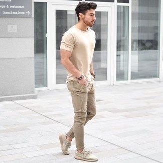 How to Wear Beige Athletic Shoes In a Relaxed Way For Men: For an off-duty look with a modernized spin, you can dress in a beige crew-neck t-shirt and khaki jeans. Take an otherwise mostly dressed-up ensemble in a more casual direction by rocking beige athletic shoes.