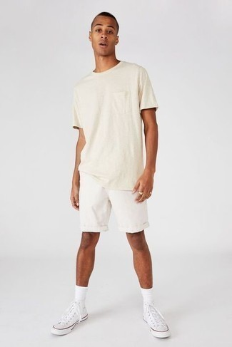 Shorts Outfits For Men: When the setting allows relaxed casual style, team a beige crew-neck t-shirt with shorts. Dial up your whole look by wearing white canvas high top sneakers.