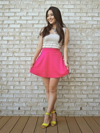 Pair a nude cropped top with a hot pink pleated skirt for a casual-cool vibe. Yellow leather heeled sandals will instantly smarten up even the laziest of looks.