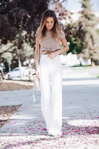 A beige cropped top and a Forever 21 Faux Leather Bucket Bag are great staples that will integrate perfectly within your current looks. Why not introduce white leather pumps to the mix for an added touch of style? We're loving that this combination is great come summertime.