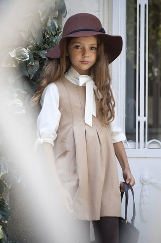 How to Wear a White Long Sleeve T-Shirt For Girls: Reach for a white long sleeve t-shirt and beige dress for your little princess for a beautiful casual get-up.