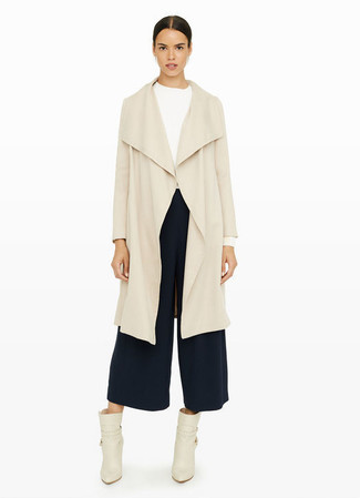 How to wear: beige duster coat, white long sleeve t-shirt, navy culottes, beige leather ankle boots