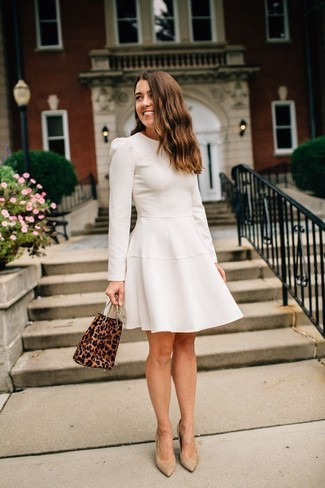How to Wear Tan Suede Pumps: Rock a beige fit and flare dress and you'll look outrageously stunning. Our favorite of a myriad of ways to complement this getup is with tan suede pumps.