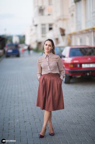 How to Wear a Floral Button Down Blouse: A floral button down blouse and a brown full skirt are the kind of a never-failing casual look that you so awfully need when you have no extra time to put together a look. For a more refined touch, introduce burgundy leather pumps to your getup.