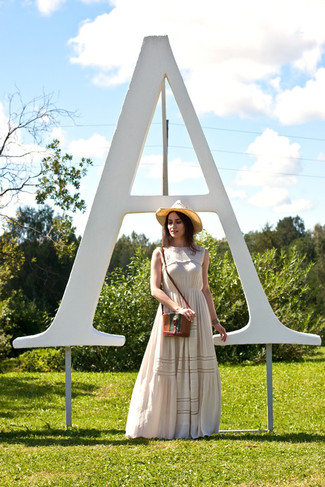 How to wear: beige floral maxi dress, brown leather crossbody bag, khaki straw hat