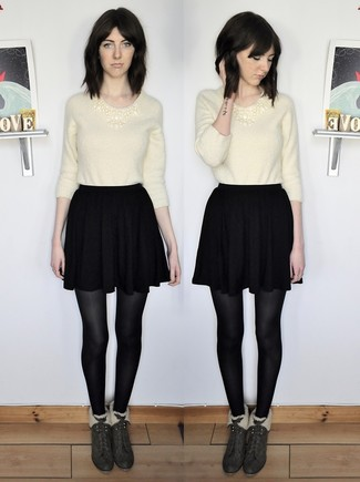How to wear: beige fluffy crew-neck sweater, black skater skirt, dark green suede ankle boots