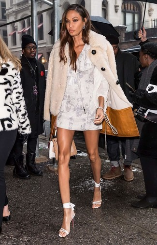 How to wear: beige fur coat, white floral shift dress, white leather heeled sandals, tan leather satchel bag