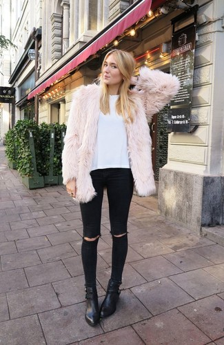 A nude fur jacket and black distressed skinny jeans are perfect for both running errands and a night out. Complement this look with black leather booties.