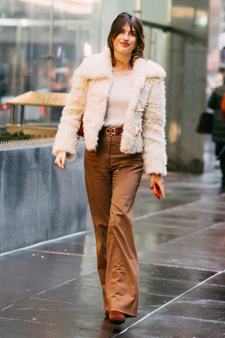 How to wear: beige fur jacket, white long sleeve t-shirt, brown flare pants, tobacco suede ankle boots