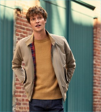 How to Wear a Tan Crew-neck Sweater For Men: Such must-haves as a tan crew-neck sweater and navy jeans are an easy way to infuse some cool into your casual rotation.