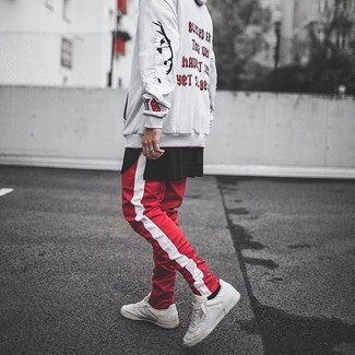 How to wear: beige print hoodie, black crew-neck t-shirt, red and white vertical striped sweatpants, white leather low top sneakers