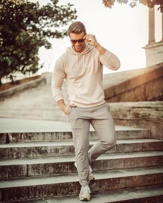 How to wear: beige hoodie, grey chinos, beige suede athletic shoes