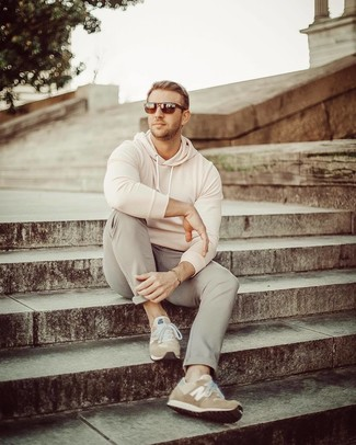 How to wear: beige hoodie, grey chinos, tan suede athletic shoes, dark brown sunglasses