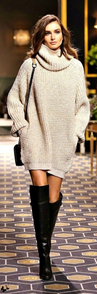 Step up your off-duty look in a beige knit sweater dress. Play down the casualness of your getup with black leather over the knee boots. We guarantee this ensemble is the perfect antidote to gloomy autumn afternoons.