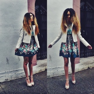 A beige leather moto jacket and a navy floral skater dress are perfect for both running errands and a night out. Beige leather heeled sandals will add elegance to an otherwise simple look.