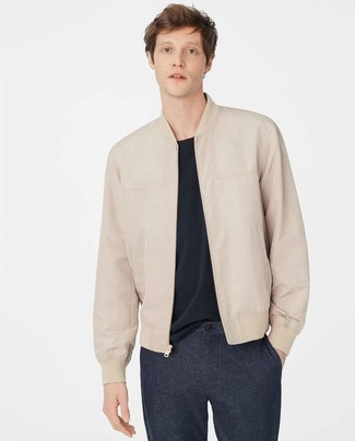 How to Wear Navy Wool Chinos: If you're hunting for a relaxed and at the same time on-trend outfit, try teaming a beige leather bomber jacket with navy wool chinos.