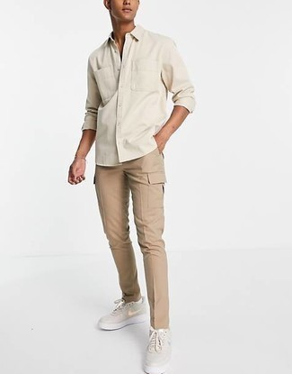 Khaki Cargo Pants Outfits: This relaxed combination of a beige long sleeve shirt and khaki cargo pants can take on different nuances depending on how you style it. If you're on the fence about how to round off, a pair of beige leather low top sneakers is a fail-safe option.