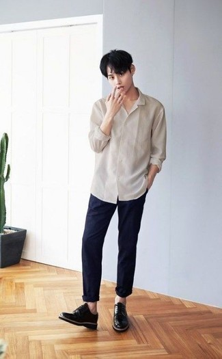 How to Wear Navy Chinos: Dress in a beige long sleeve shirt and navy chinos if you seek to look casually cool without exerting much effort. And if you need to instantly perk up this getup with one single item, complete this getup with a pair of black leather derby shoes.