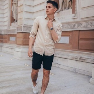 Navy Shorts Outfits For Men: This combination of a beige long sleeve shirt and navy shorts looks awesome and makes you look instantly cooler. For a more casual twist, add white athletic shoes to the equation.