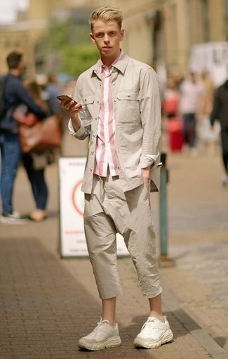How to Wear Beige Athletic Shoes For Men: Wear a pink vertical striped short sleeve shirt with beige chinos to pull together an everyday getup that's full of style and character. Let your styling savvy truly shine by completing your outfit with a pair of beige athletic shoes.