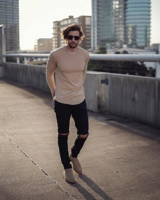 Beige Long Sleeve T-Shirt Outfits For Men: Definitive proof that a beige long sleeve t-shirt and black ripped jeans look awesome when paired together in a street style ensemble. Beige suede chelsea boots will immediately polish off even the most basic of looks.