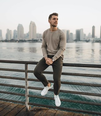 Beige Long Sleeve T-Shirt Outfits For Men: A big yes to this laid-back combination of a beige long sleeve t-shirt and dark brown jeans! Add a pair of white and green leather low top sneakers to your outfit and you're all done and looking smashing.