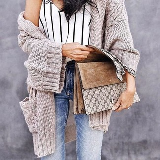 How to wear: beige knit open cardigan, white and black vertical striped tank, light blue skinny jeans, tan suede satchel bag