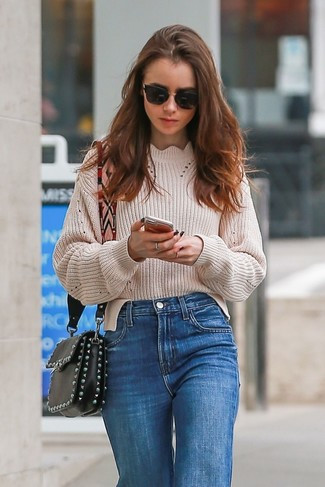 How to wear: beige knit oversized sweater, blue jeans, black embellished leather crossbody bag, black sunglasses